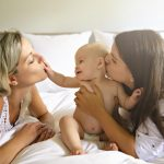 Two Lesbian Mother And Baby On Bed Having Fun